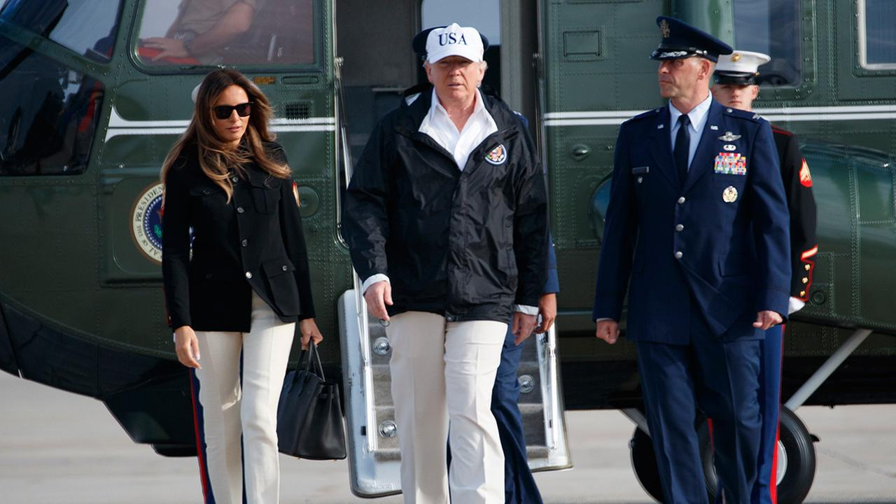 President Donald Trump and first lady Melania Trump walk to board Air Force One for a trip to Florida to meet those impacted by Hurricane Irma, Thursday, September 14, 2017.