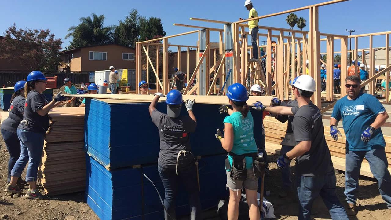 Volunteers work on a Habitat Humanity housing project in Fremont, Calif. on Friday, Sept. 15, 2017.