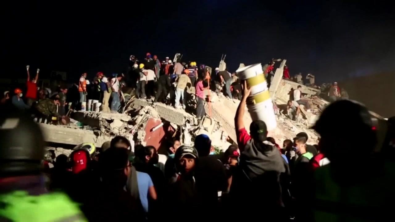 Rescuers dig through rubble after 7.1 magnitude earthquake in Mexico on Wednesday, September 20, 2017.
