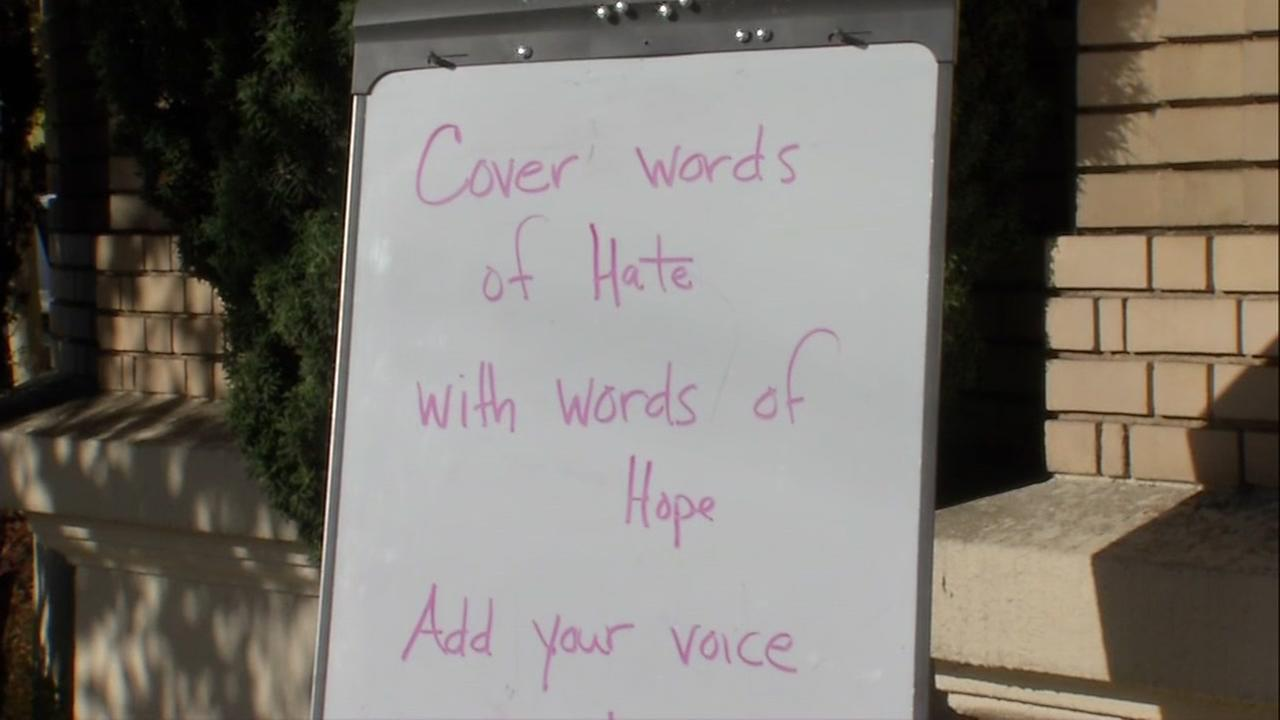 A board appears outside Temple Sinai encouraging people to leave messages of love after anti-Semitic graffiti was discovered there.