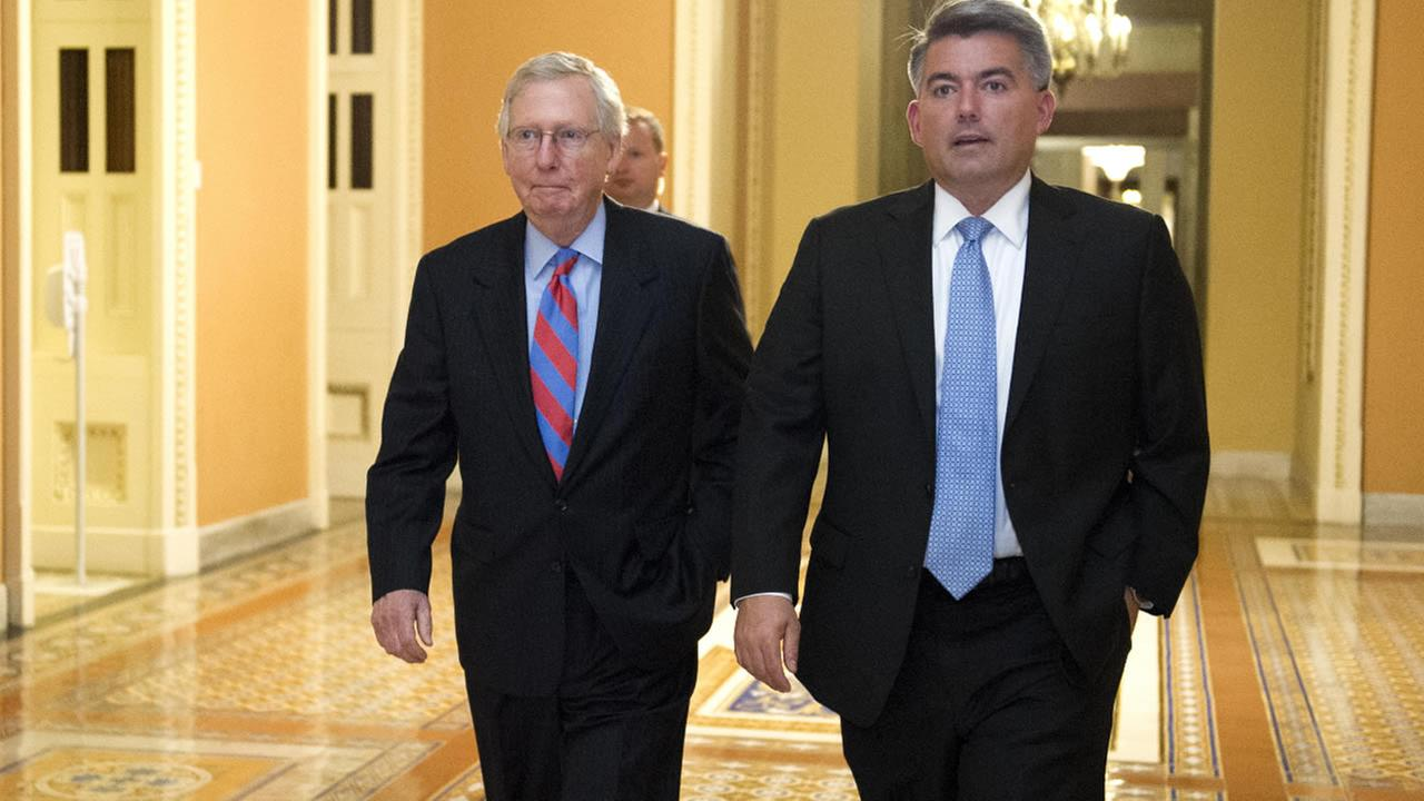 Senate Majority Leader Mitch McConnell of Ky., left, and Sen. Corey Gardner, R-Colo., walk to the Senate Chamber  in Washington, Thursday, July 27, 2017. (AP Photo/Cliff Owen)