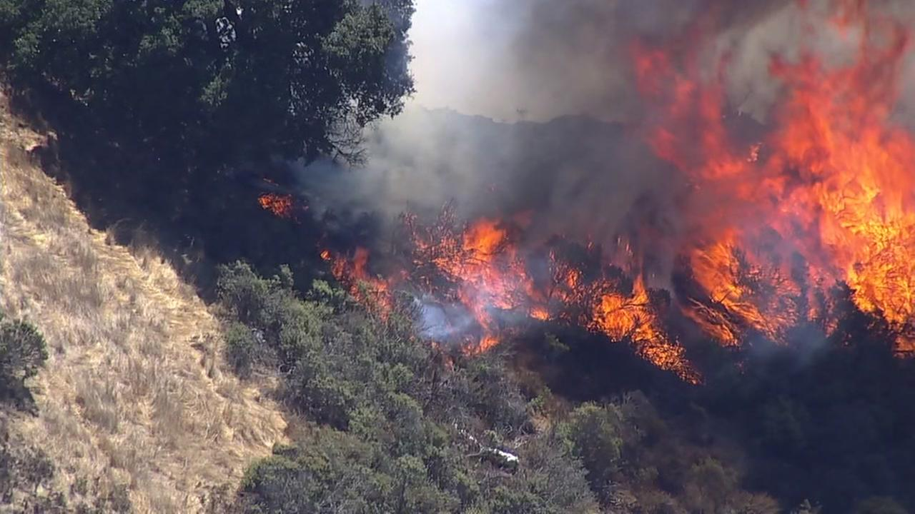 Brush fire burning in Oakland, California, Tuesday, September 26, 2017.