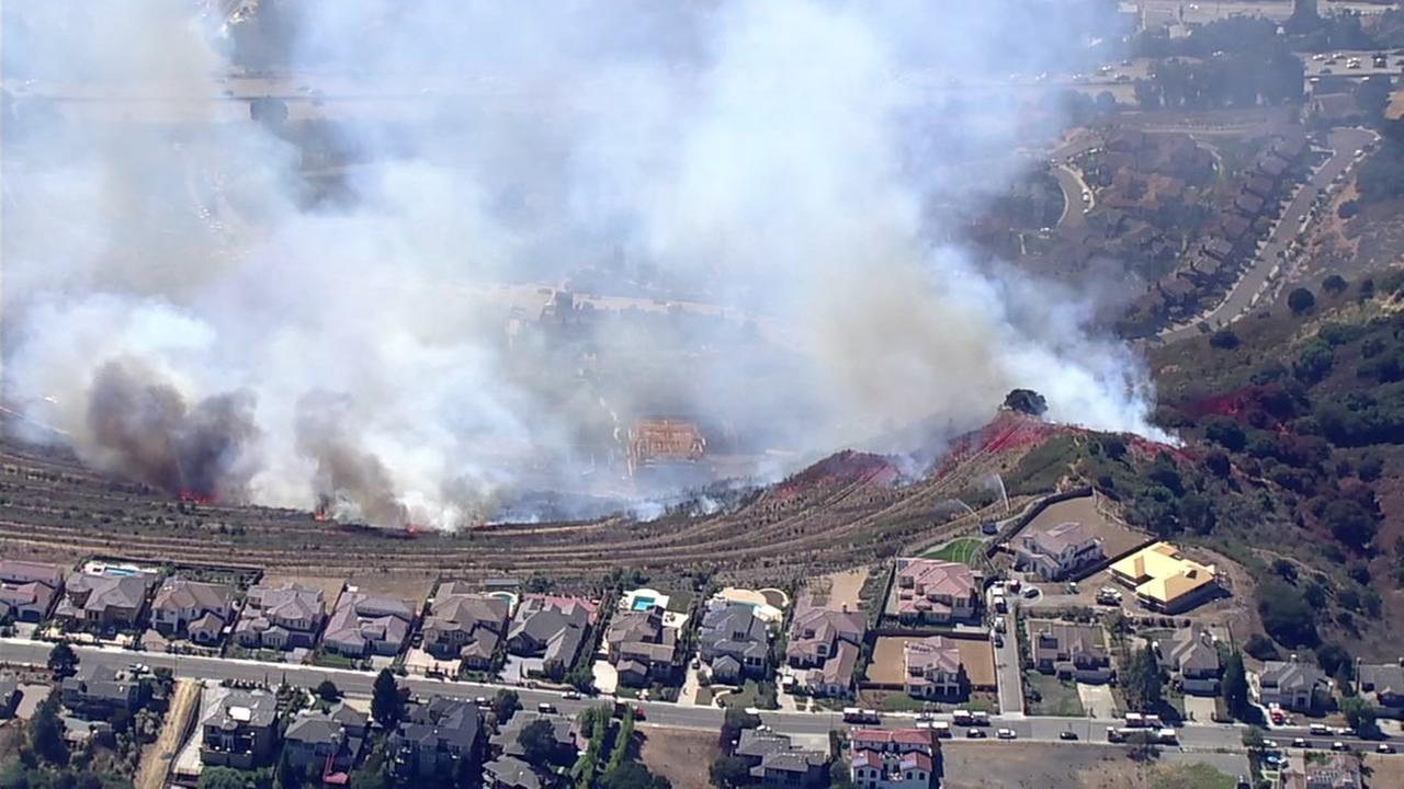 Large brush fire burns near several homes in Oakland Hills, California on Tuesday, September 26, 2017.