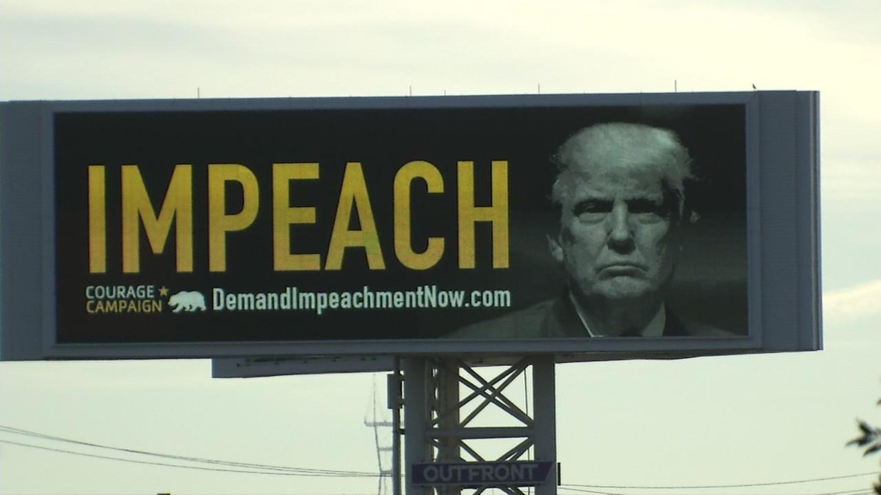 A billboard advertising the impeachment of President Donald Trump appears in Oakland, Calif. on Sept. 25, 2017.