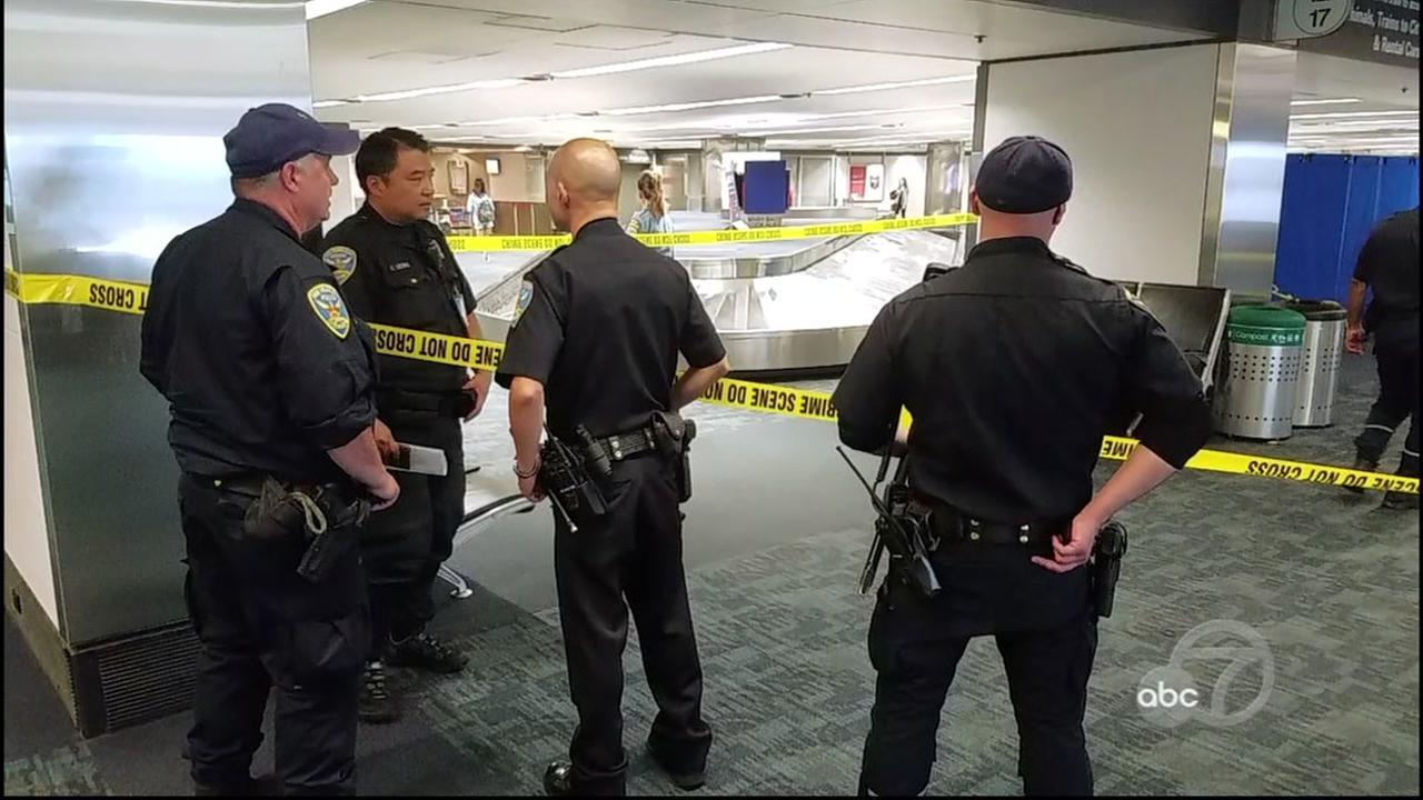 San Francisco police officers corden off a crime scene at SFO on Sept. 26, 2017.