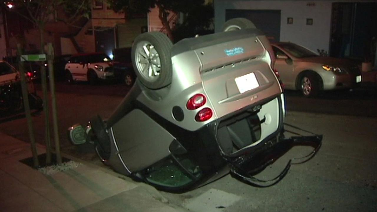 San Francisco police are investigating why vandals flipped three Smart cars around the city overnight.