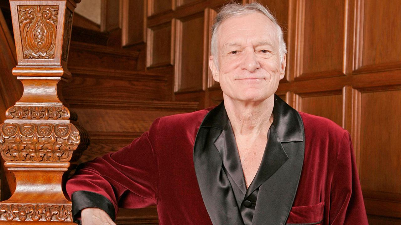 FILE - In this April 7, 2006 file photo, Playboy founder Hugh Hefner poses at the Playboy Mansion in the Holmby Hills area of Los Angeles.