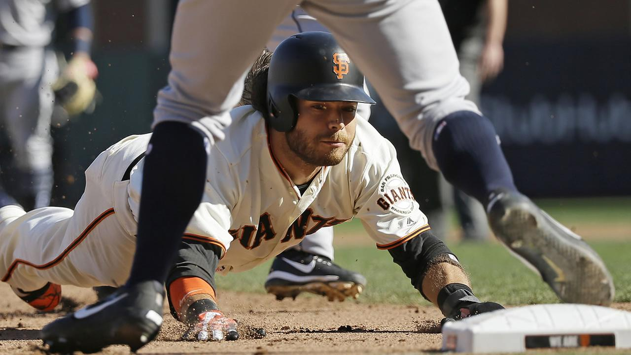 Szczur scores trying run in 9th in Padres' win over Giants