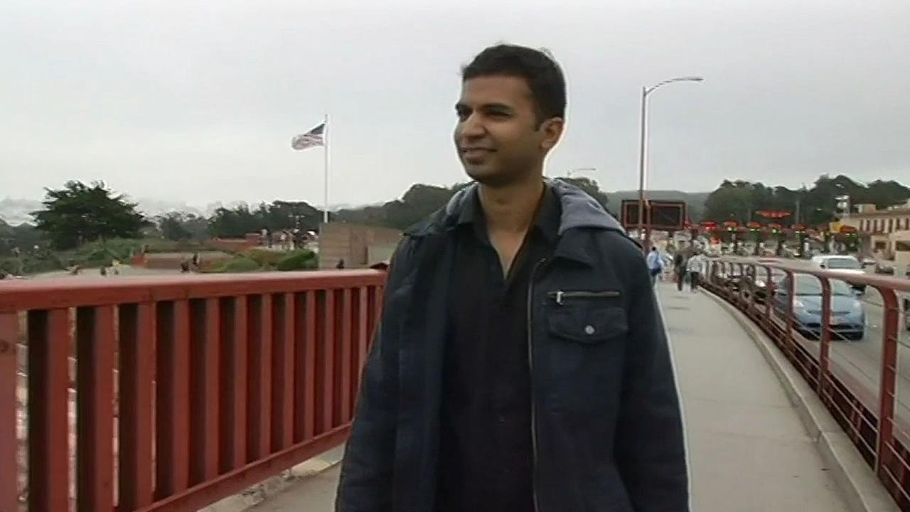Traveler Rajeev Gupta from India walking across the Golden Gate Bridge