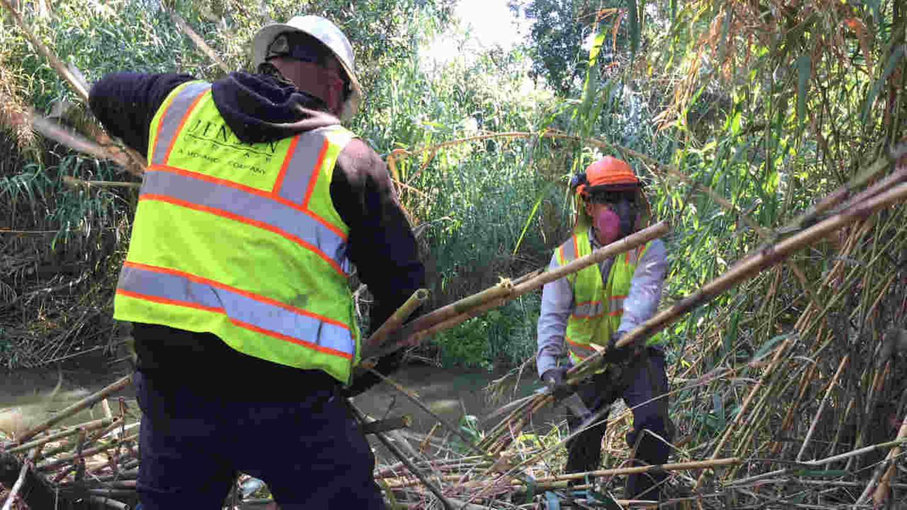 Crews are seen preparing Coyote Creek for winter in San Jose, Calif. on Wednesday, October 4, 2017.