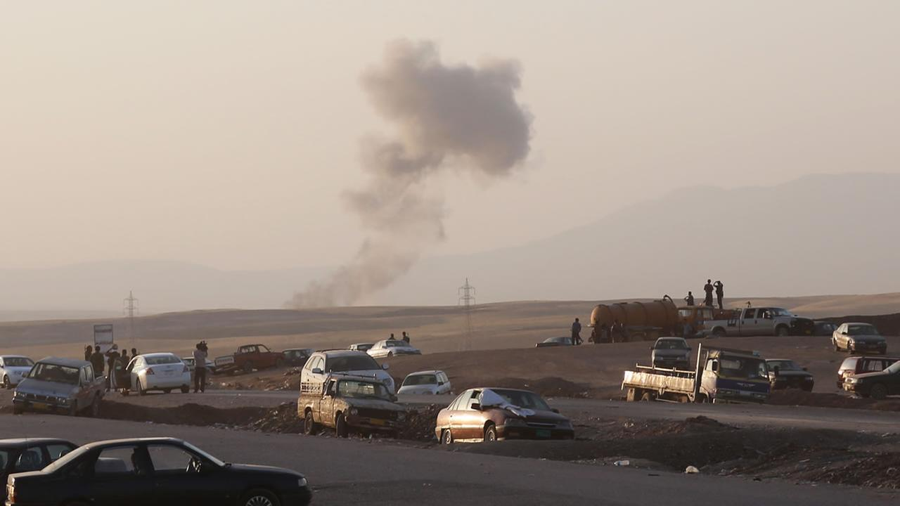 Smoke rises after airstrikes targeting Islamic State militants outside of the city of Irbil in northern Iraq.