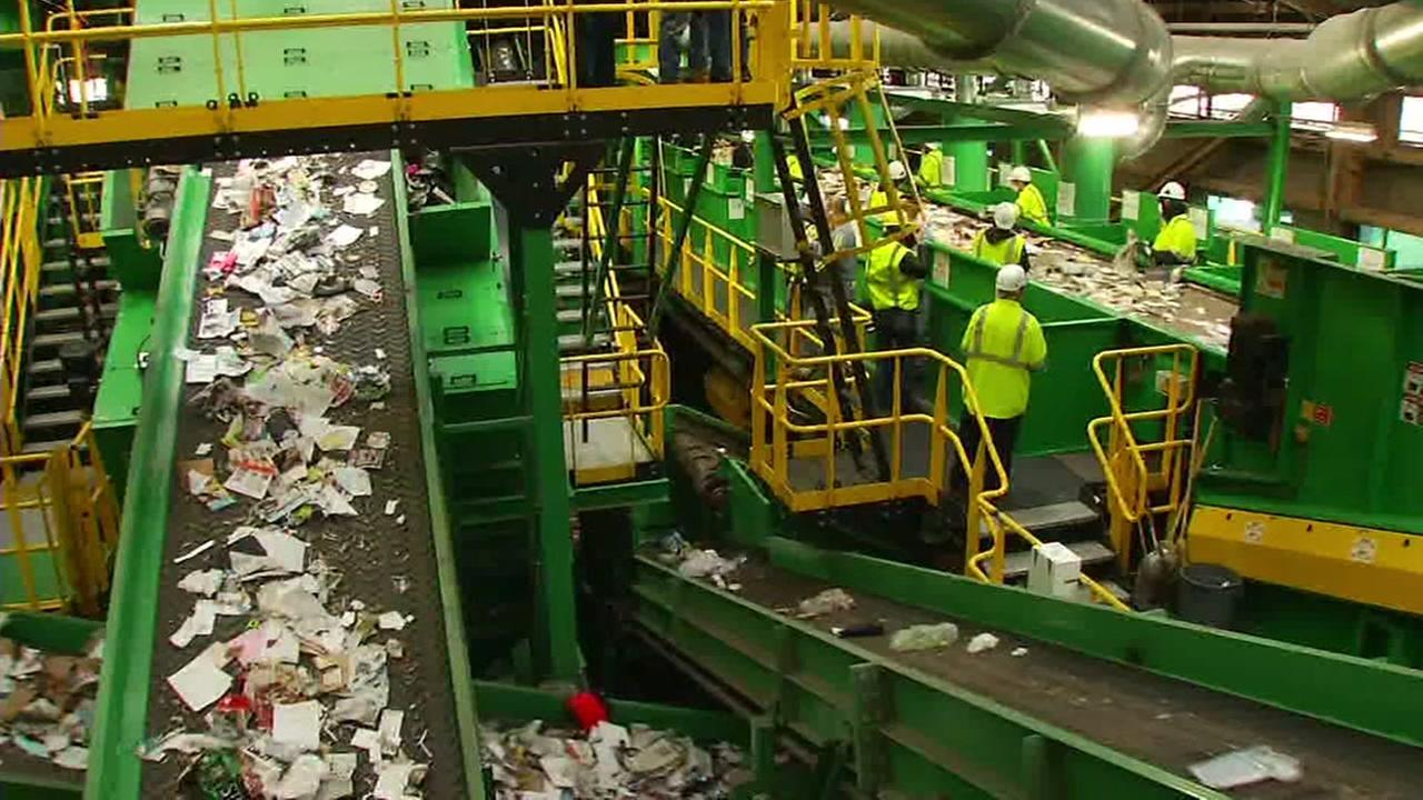 Recycling sorters work in San Francisco on Thursday, Oct. 5, 2017.