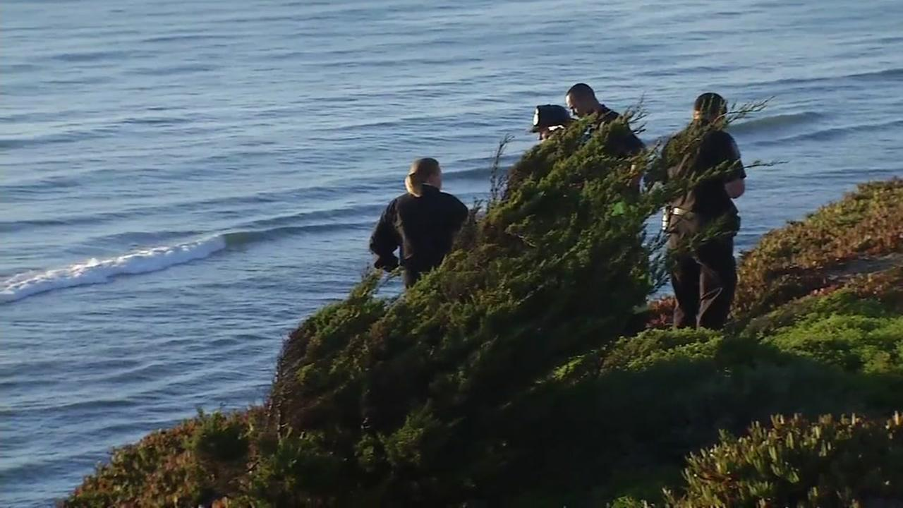 Officials investigate the area near Fort Funston in San Francisco on Thursday, Oct. 5, 2017.
