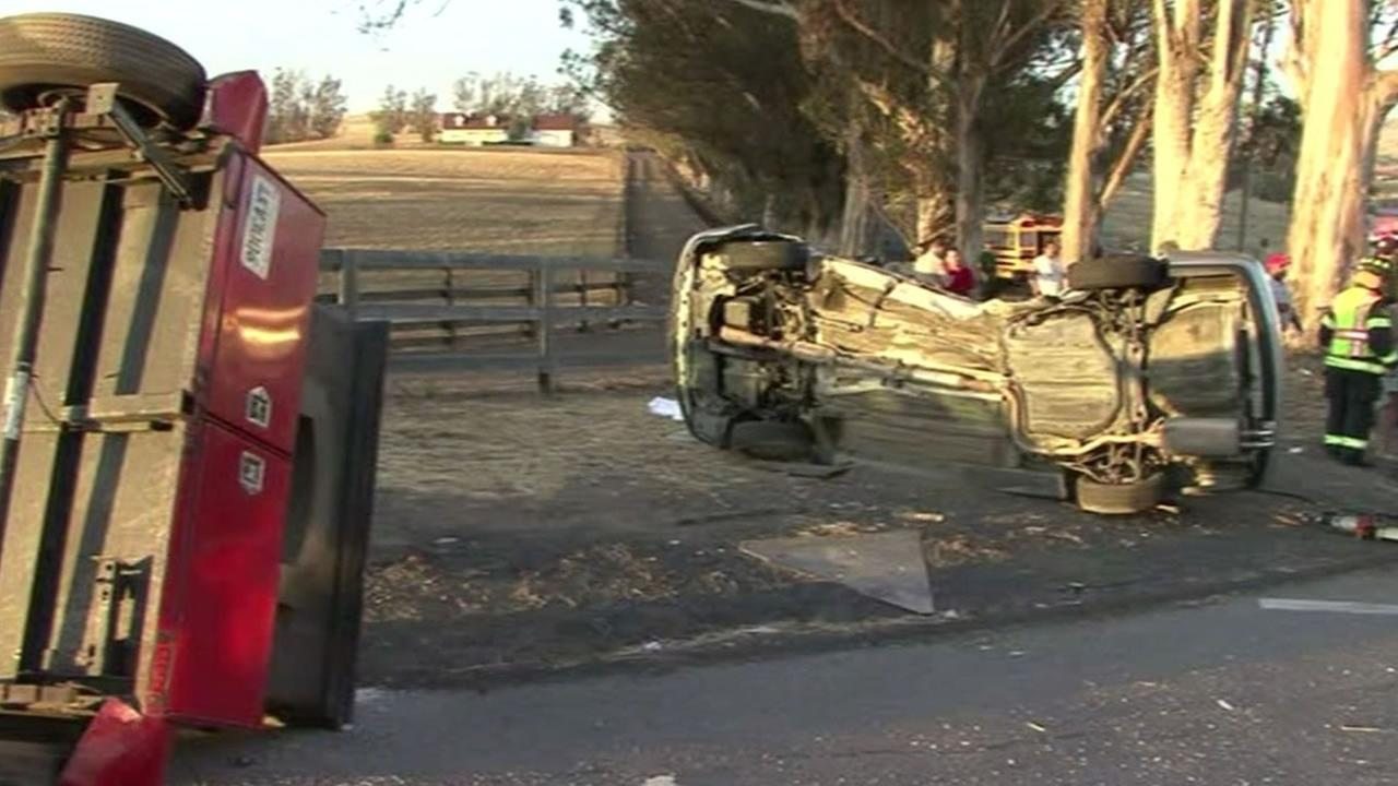 bad car wreck after a trailer with a pizza oven crashed into a family car