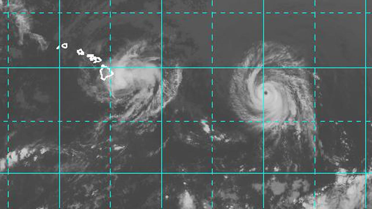 This image provided by NOAA taken at 2 a.m. EDT Friday Aug. 8, 2014 shows Hurricane Iselle approaching the Island of Hawaii, left as Hurricane Julio with a well defined eye follows. (AP Photo/NOAA)