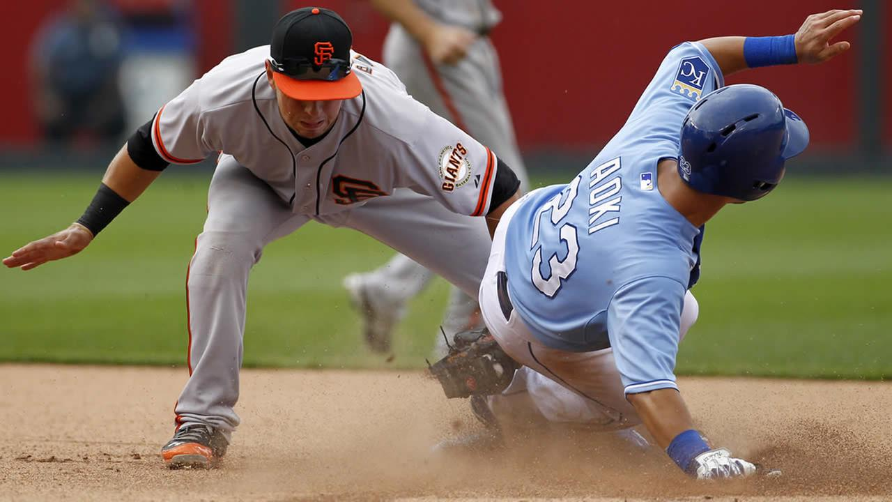 Kansas City Royals Norichika Aoki, right, safely steals second base as San Francisco Giants second baseman Joe Panik, left, gets the late throw in Kansas City, Mo., Aug. 10, 2014. (AP Photo/Colin E. Braley)