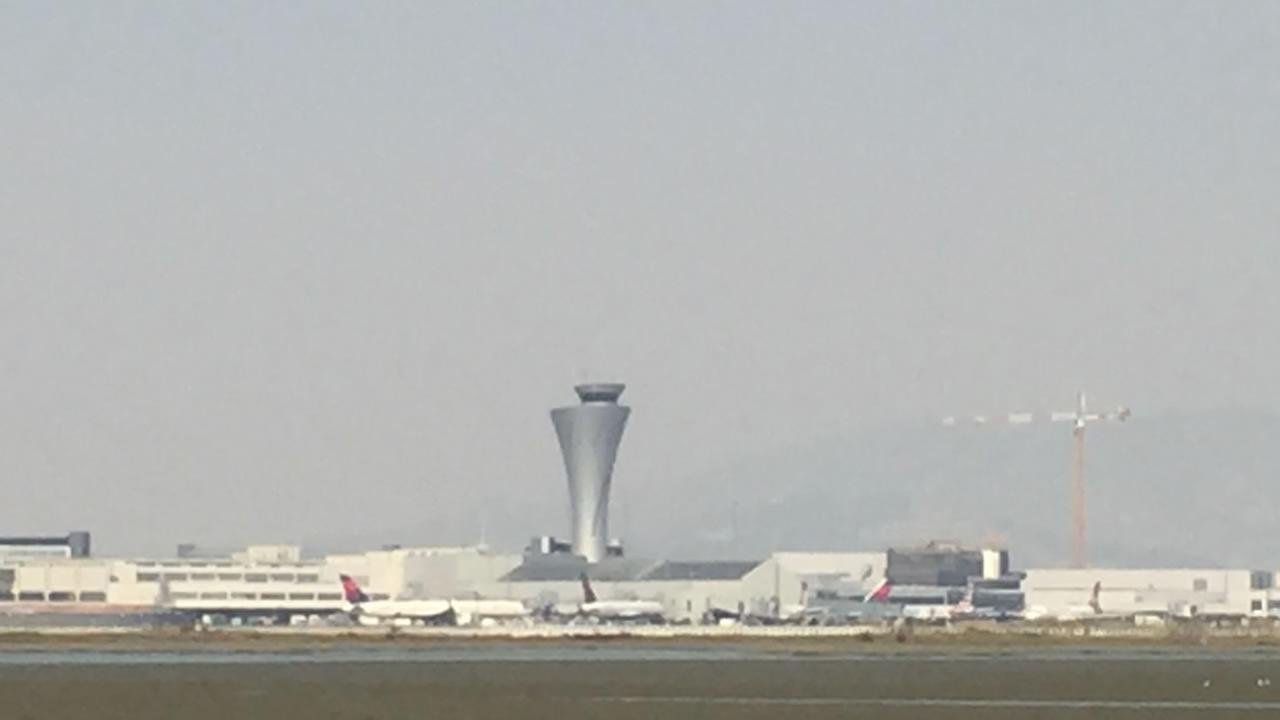 Smoke surrounds a tower at San Francisco International Airport on Thursday, Oct. 12, 2017.