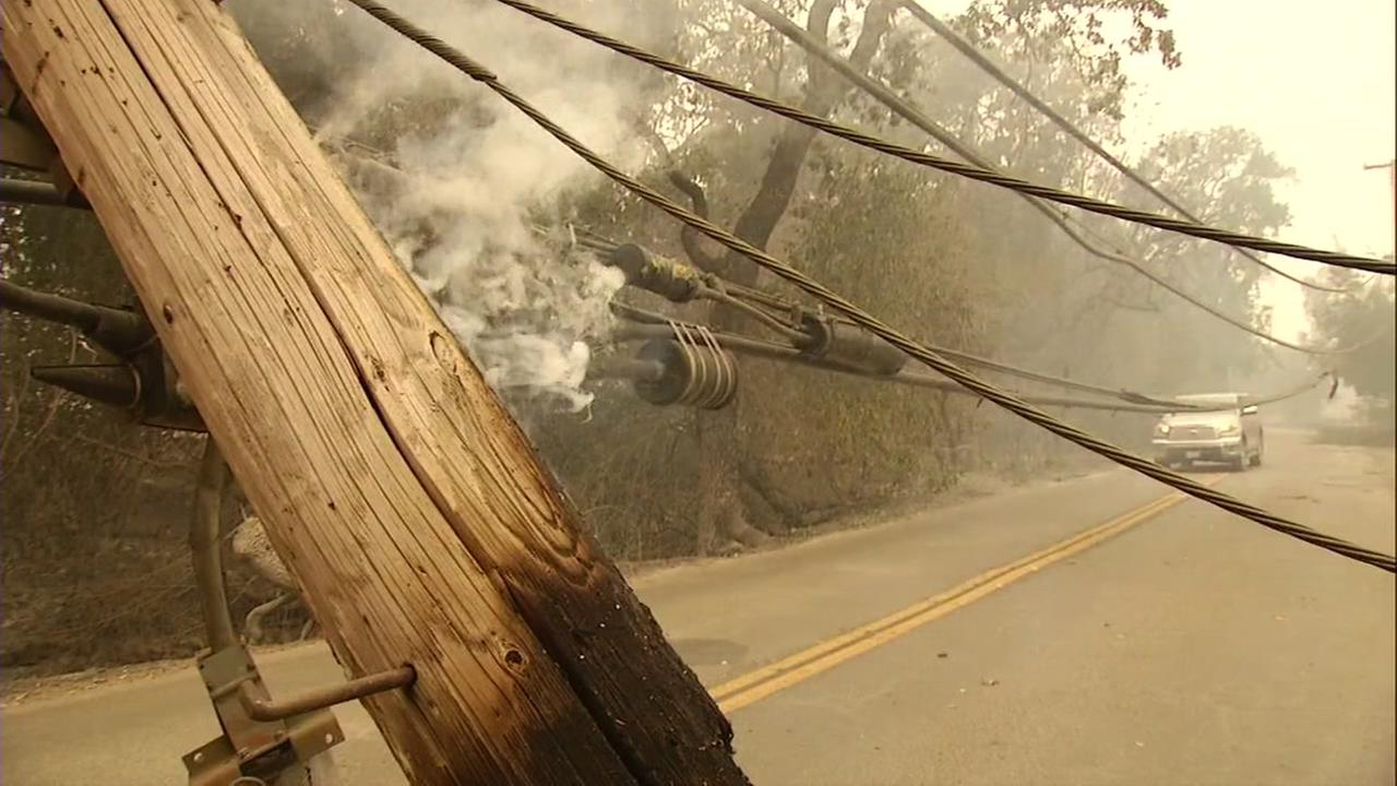 Smoke emits from powerlines in Sonoma, Calif. on Thursday, Oct. 12, 2017.