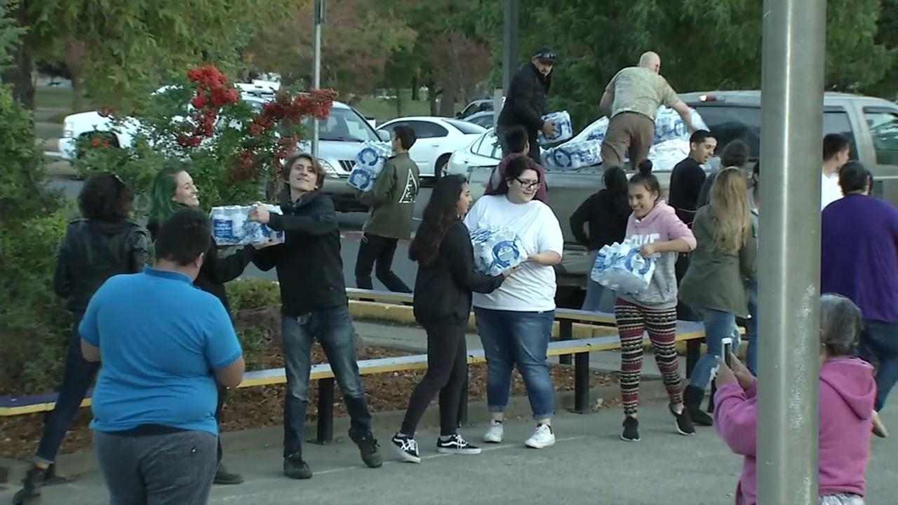 Volunteers help fire victims in Mendocino County, California, Friday, October 13, 2017.