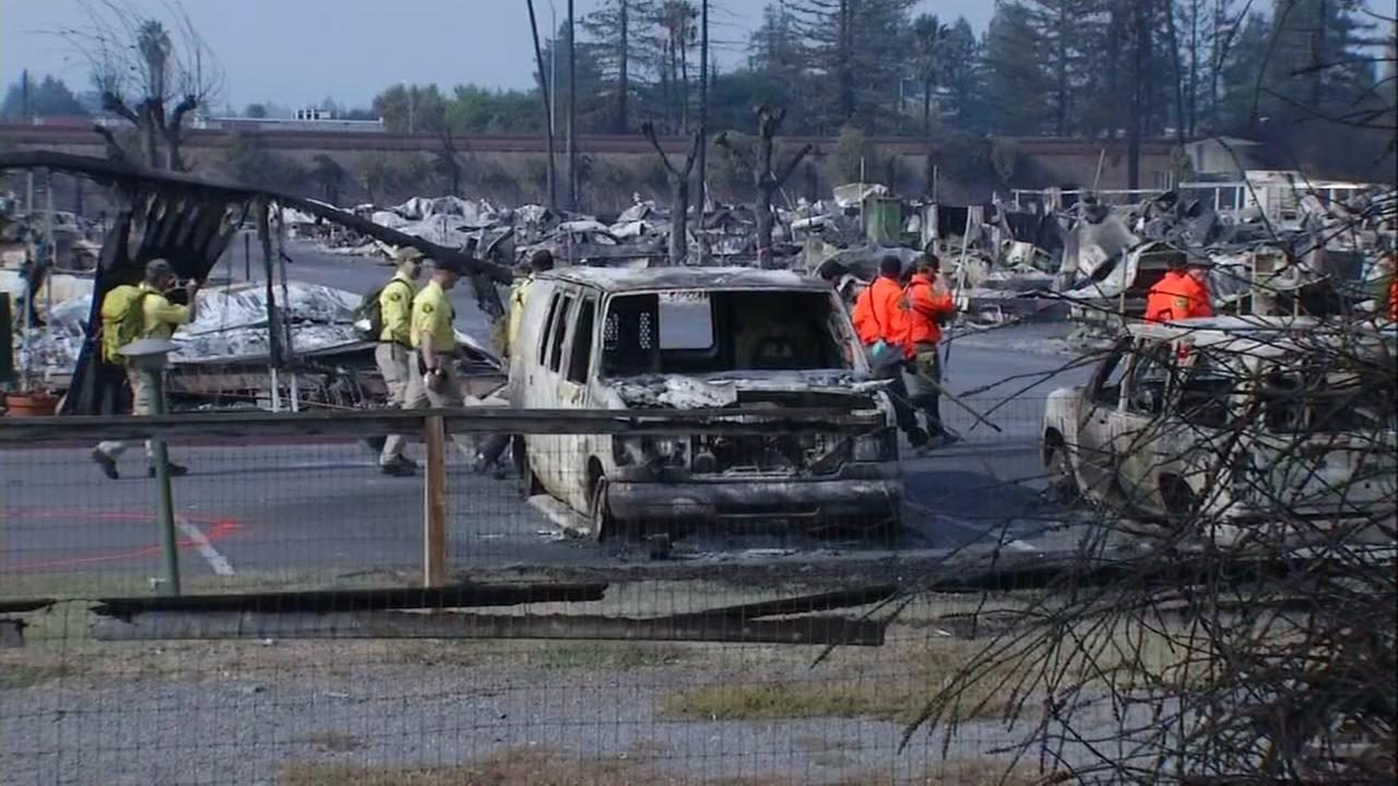 Sonoma County officials are seen at the Journeys End mobile home park in Santa Rosa, Calif. on Friday, October 13, 2013.