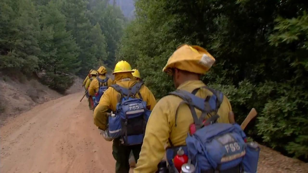 Firefighters march toward the fire line in Calistoga, Calif. on Friday, Oct. 13, 2017.