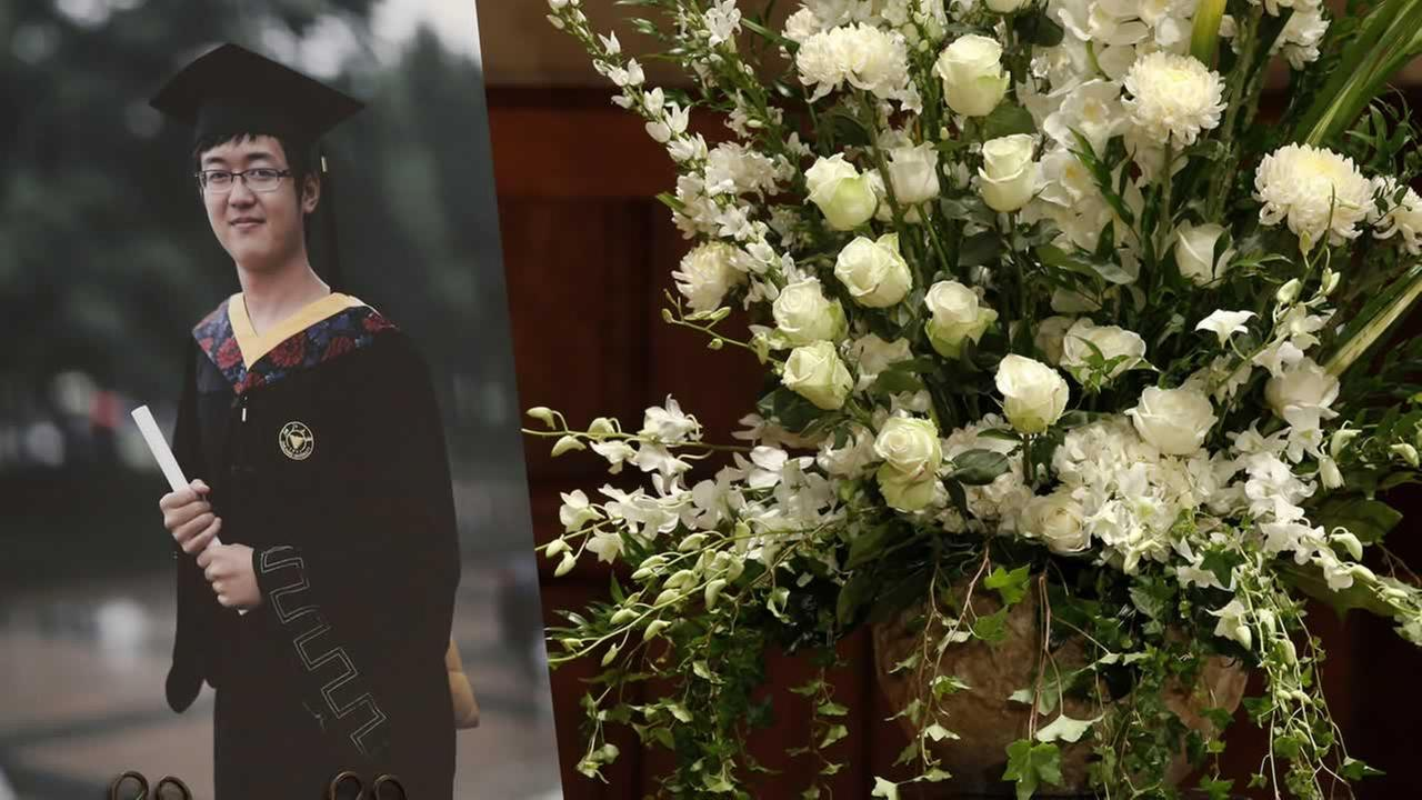 A photo of grad student Xinran Ji sits next to a flower arrangement during his memorial service at USC in Los Angeles on Aug. 1, 2014. (AP Photo/Los Angeles Times, Robert Gauthier, Pool)
