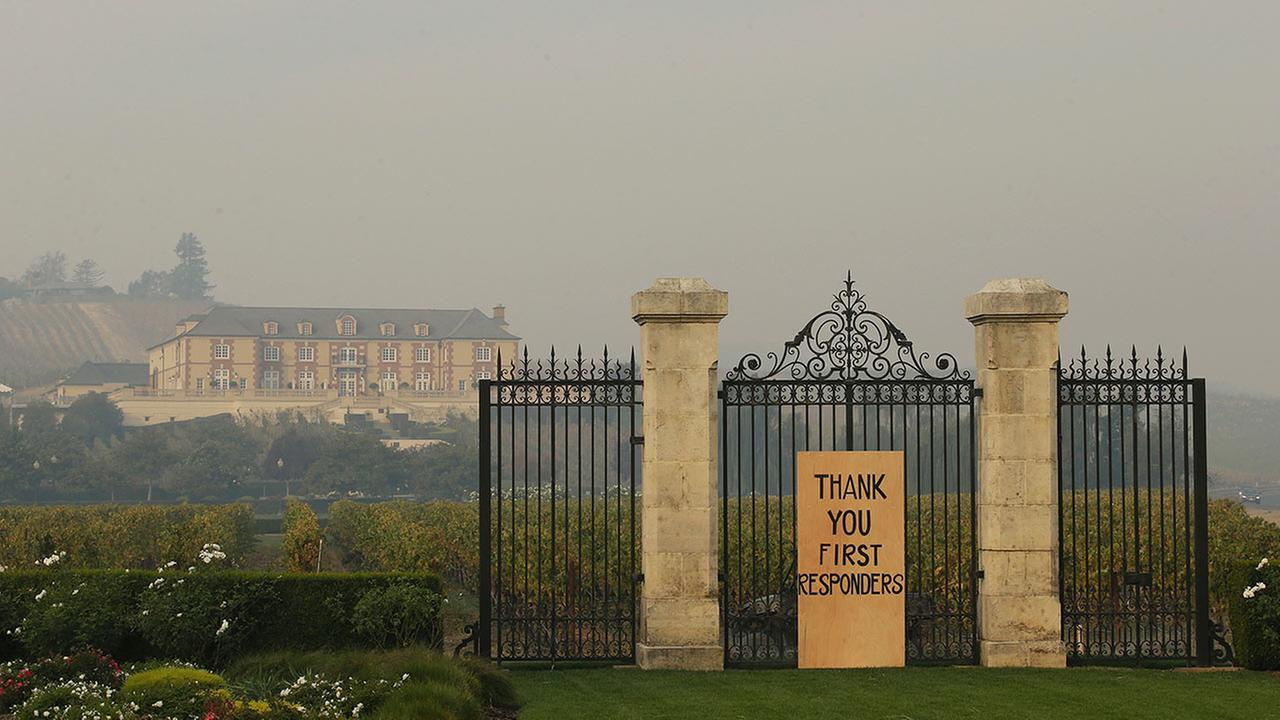 A sign sits outside the Domaine Carneros Winery, Tuesday, Oct. 17, 2017, in Santa Rosa, Calif.