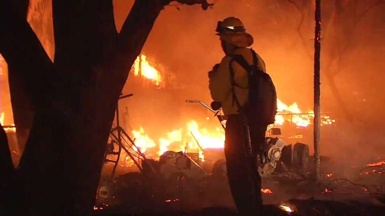 A firefighters battles flames in Sonoma County during the historic North Bay fires in Oct. 2017.