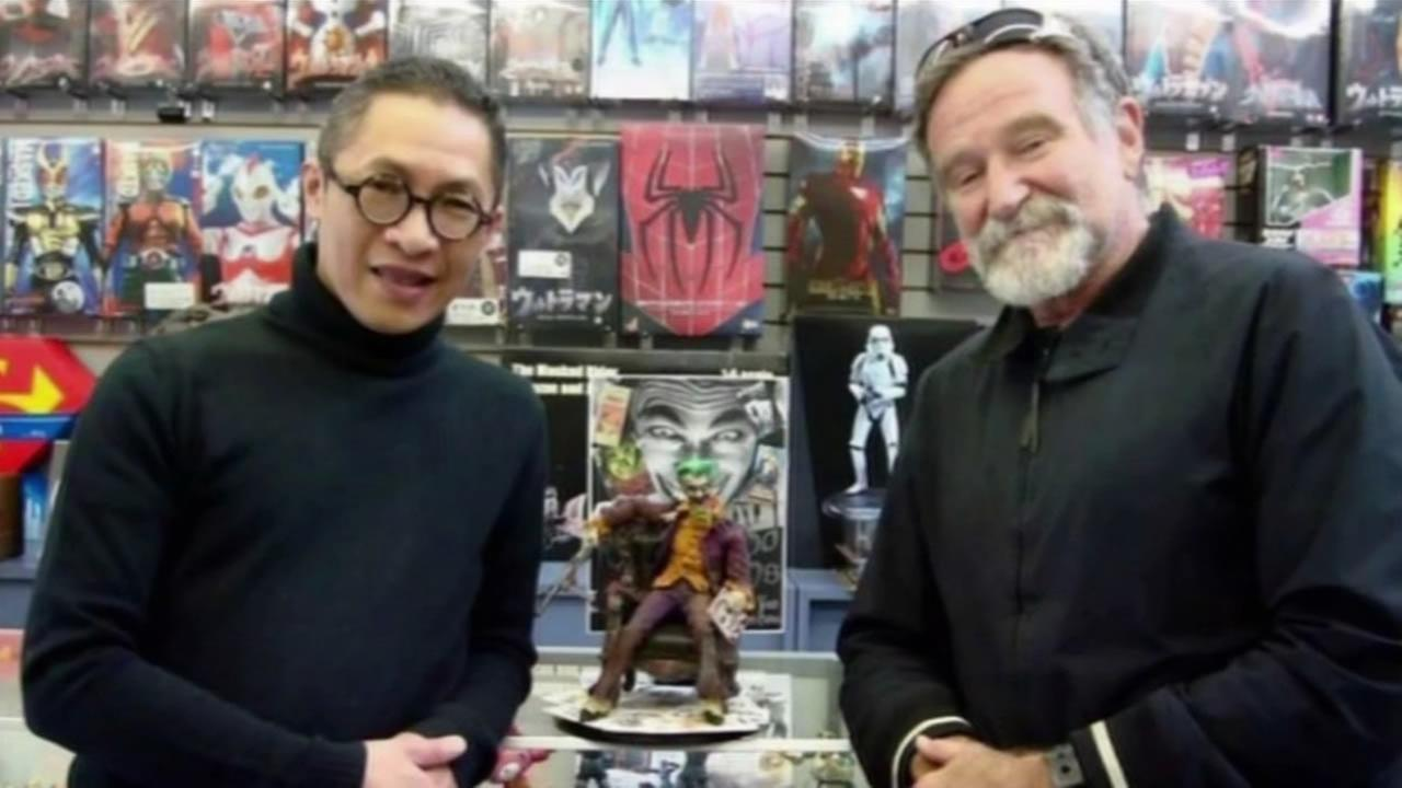 San Francisco toy store owner Robin Kwok stand with his friend and customer Robin Williams.
