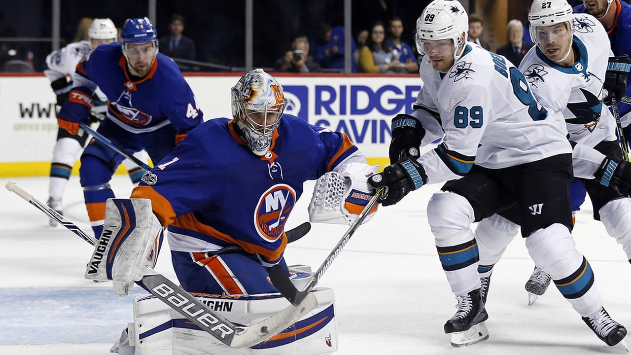 New York Islanders goalie Thomas Greiss stops a shot by San Jose Sharks Mikkel Boedker (89) in the third period of an NHL hockey game, Saturday, Oct. 21, 2017, in New York. The Islanders won 5-3. (AP Photo/Adam Hunger)