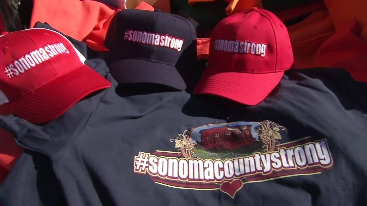 FILE -- Hats and shirts sold for Sonoma County fire relief