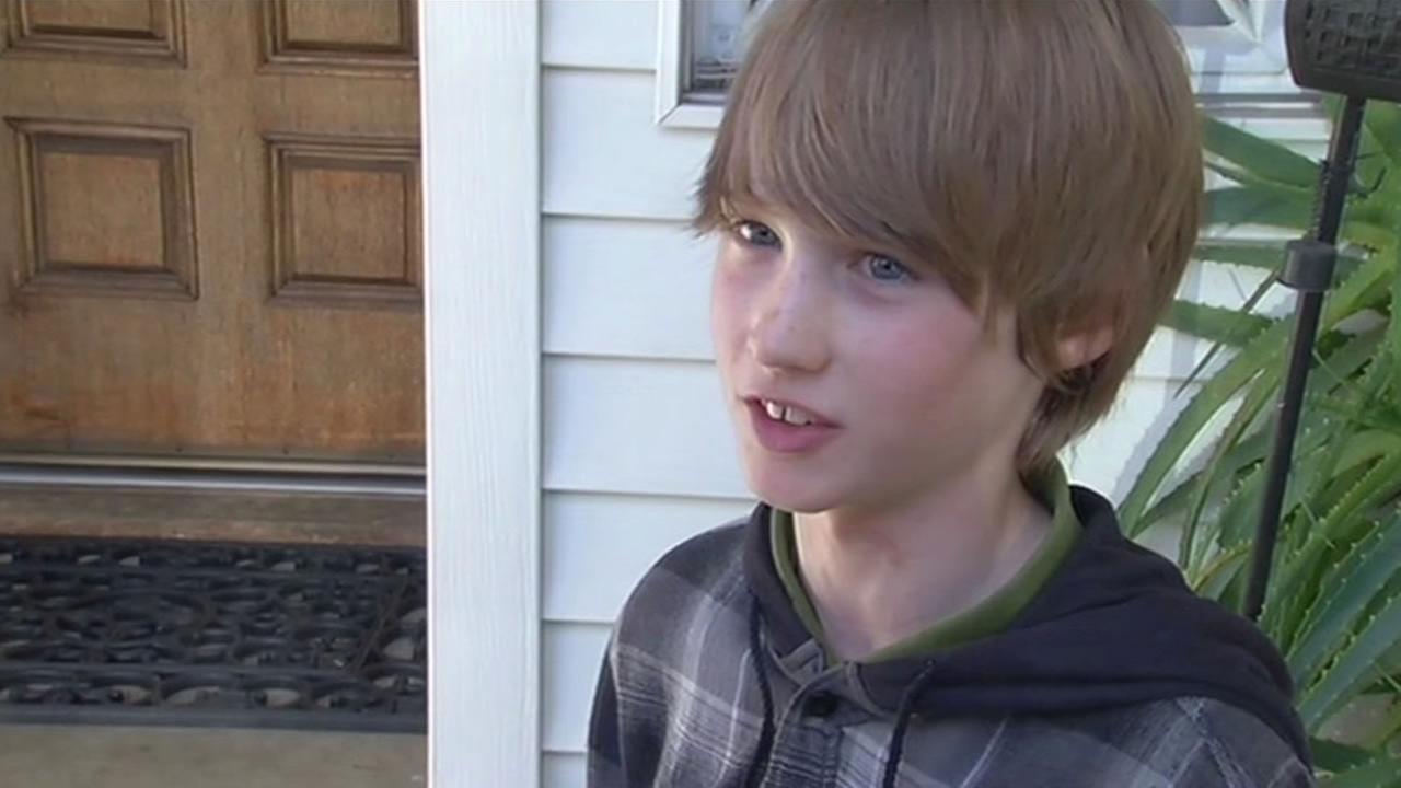 Nine-year-old Bode Beirdneau is being called a hero for finding help after a snowmobile accident.