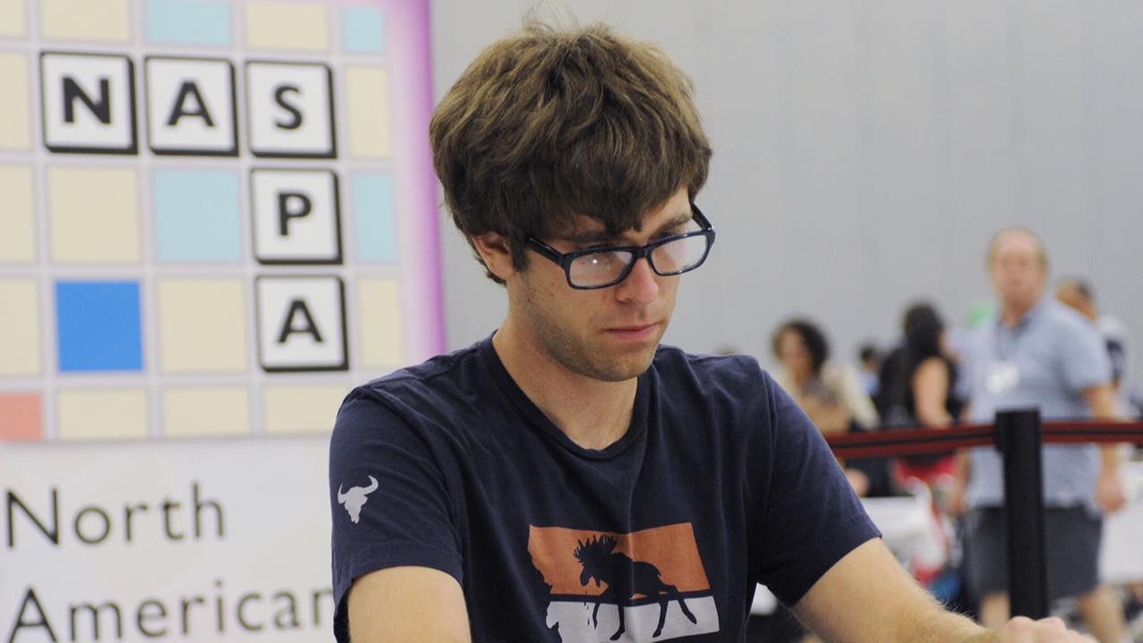 Conrad Bassett-Bouchard reacts after he won the title at the National Scrabble Championships.