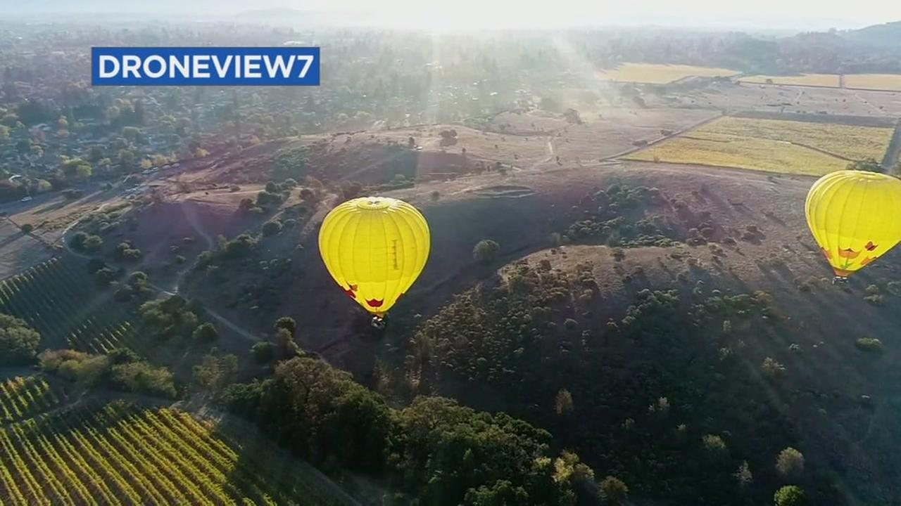 This image from DroneView7 shows hot air balloons in Napa, Calif. on Friday, Oct. 27, 2017.