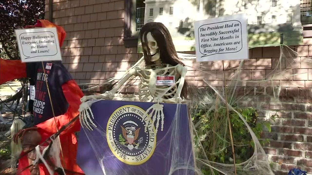 Political decorations are seen at a house in Alameda, Calif. on Friday, Oct. 27, 2017.