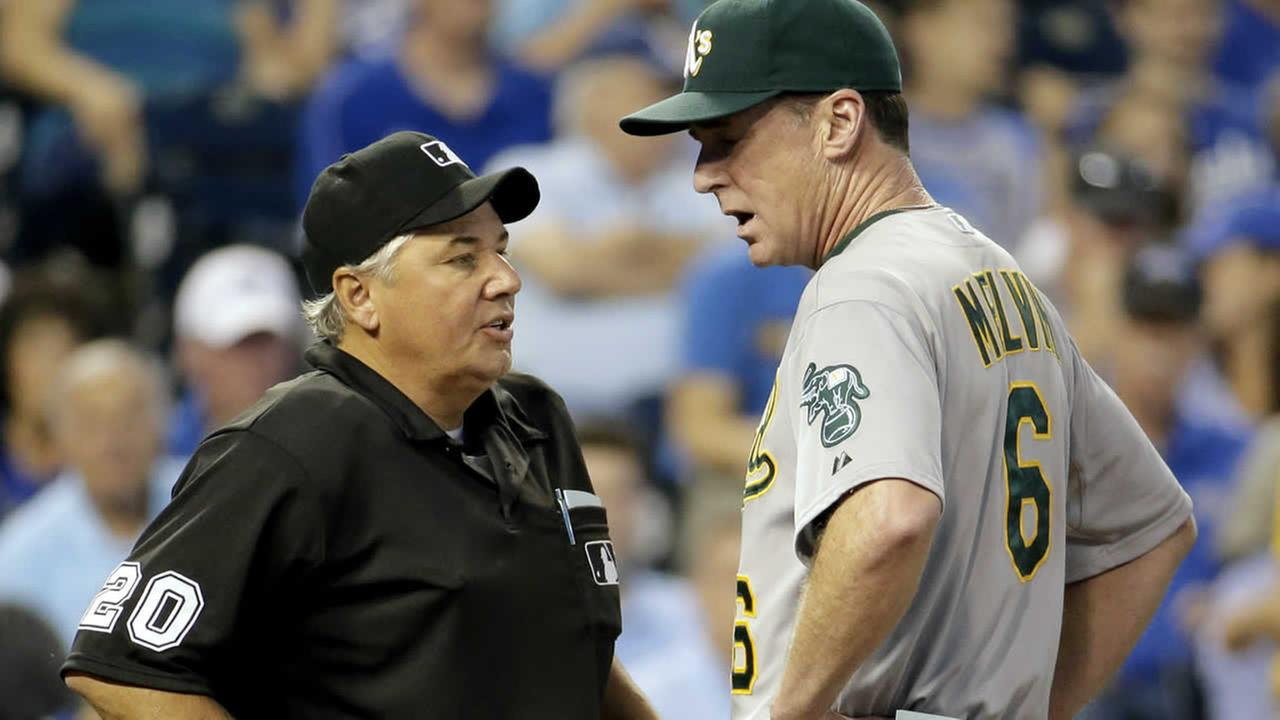 Oakland Athletics manager Bob Melvin disputes a call with home plate umpire Tom Hallion during a baseball game against the Kansas City Royals  Aug. 13, 2014, in Kansas City, Mo. (AP Photo/Charlie Riedel)