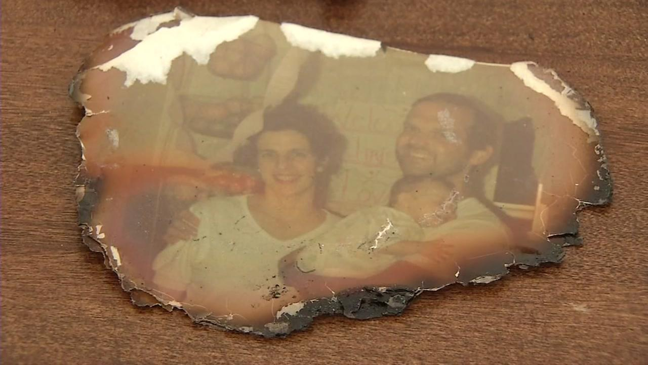 A burnt photograph of Susi Hulac and her family is seen recovered from the North Bay fires on Tuesday, Oct. 31, 2017.