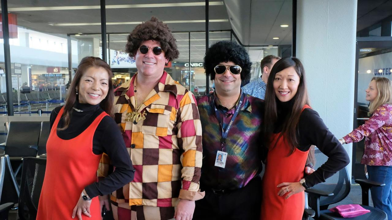 The United Airlines flight crew dons their 70s best for a retro flight celebrating the last time Uniteds Boeing 747 will fly in San Francisco, Calif. on Tuesday, Nov. 7, 2017.