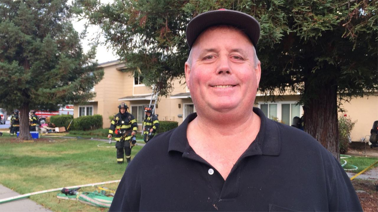 Chris Flores help save residents from a burning townhouse complex in San Jose, California, November 9, 2017.