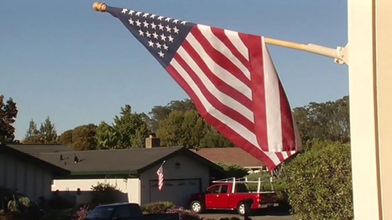 The American flag being flown outside a home in San Rafael