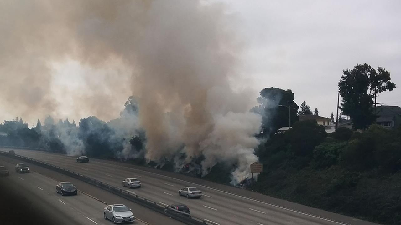 Multiple grass fires burn along Interstate 580 in Oakland