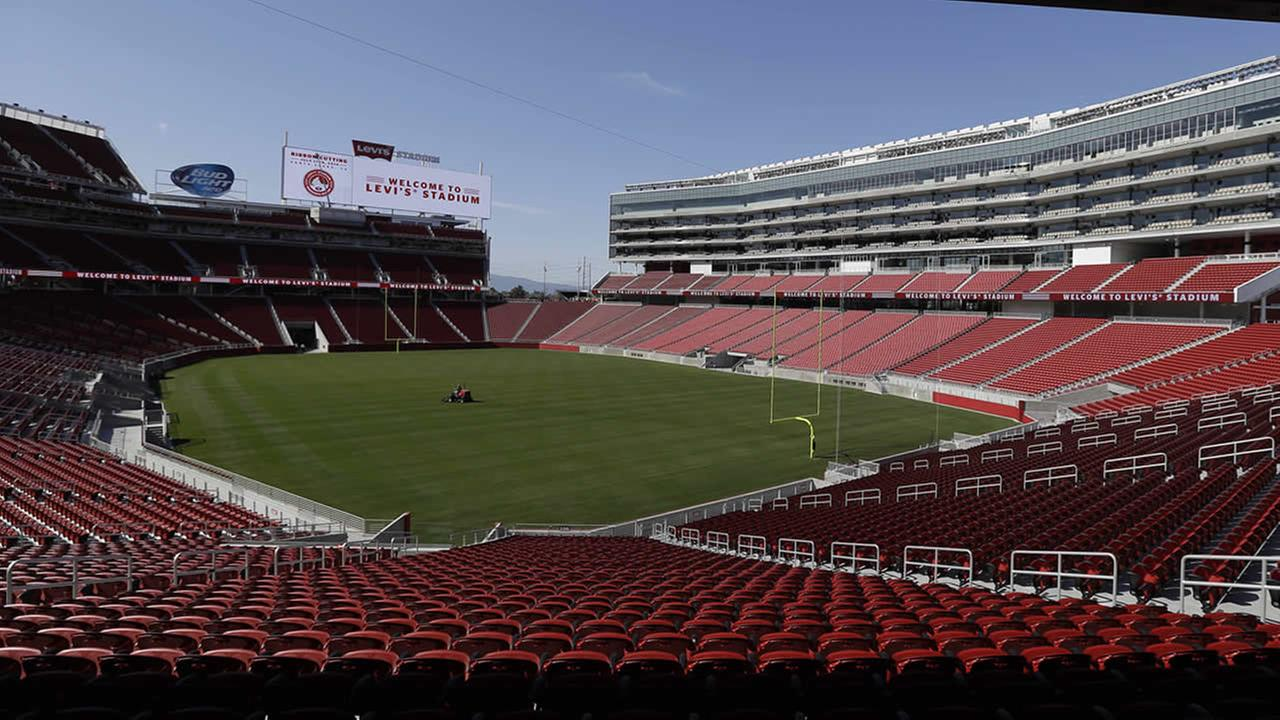 FILE - In this July 17, 2014, file photo, a groundskeeper drives across the field before the ribbon-cutting and opening of Levis Stadium, in Santa Clara, Calif. (AP Photo/Eric Risberg, File)