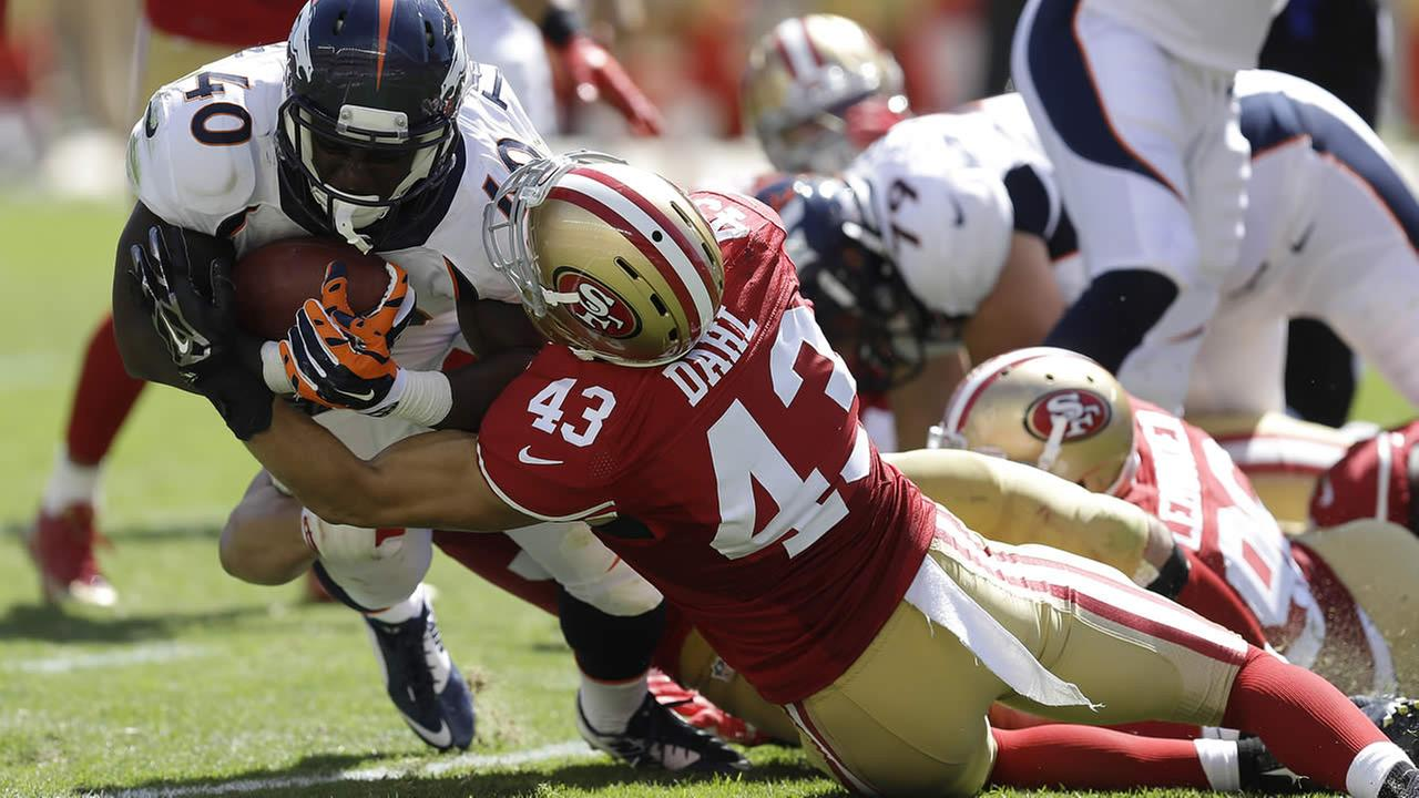 Broncos running back Juwan Thompson (40) is tackled by 49ers strong safety Craig Dahl (43) during the NFL preseason game in Santa Clara, Calif., Aug. 17, 2014.(AP Photo/Ben Margot)