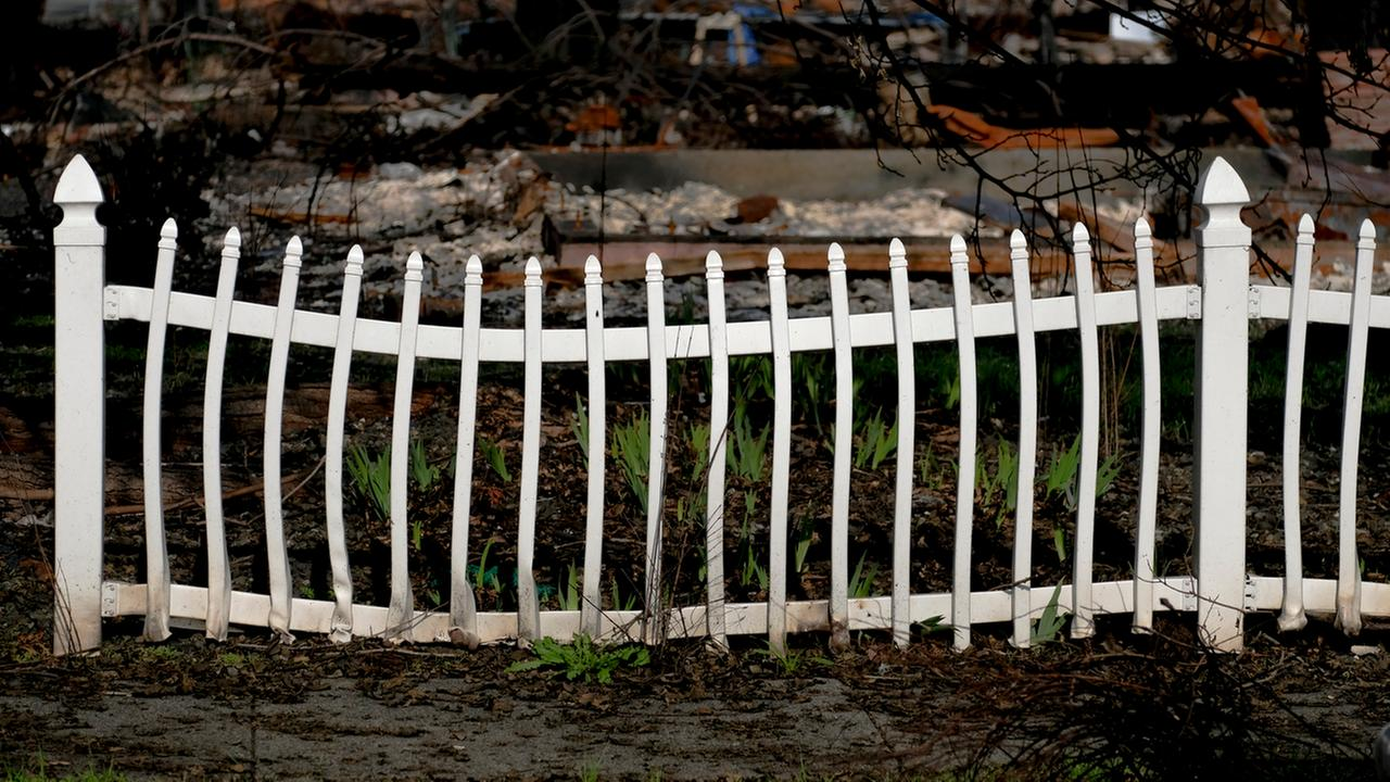 A warped plastic fence is seen in the Coffey Park neighborhood of Santa Rosa, Calif. in this undated image.