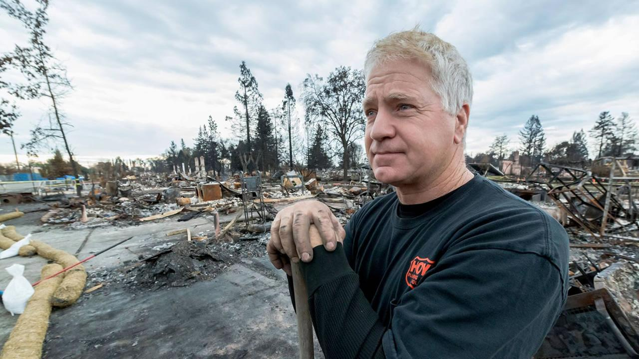 Brian Hoyt is seen as he cleans up his fire-ravaged home in Santa Rosa, Calif. on Thursday, Nov. 23, 2017.