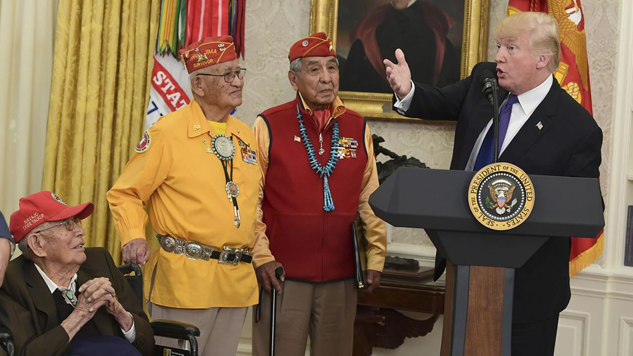 President Donald Trump, right, speaks during a meeting with Navajo Code Talkers at the White House in Washington, Monday, Nov. 27, 2017. (AP Photo/Susan Walsh)