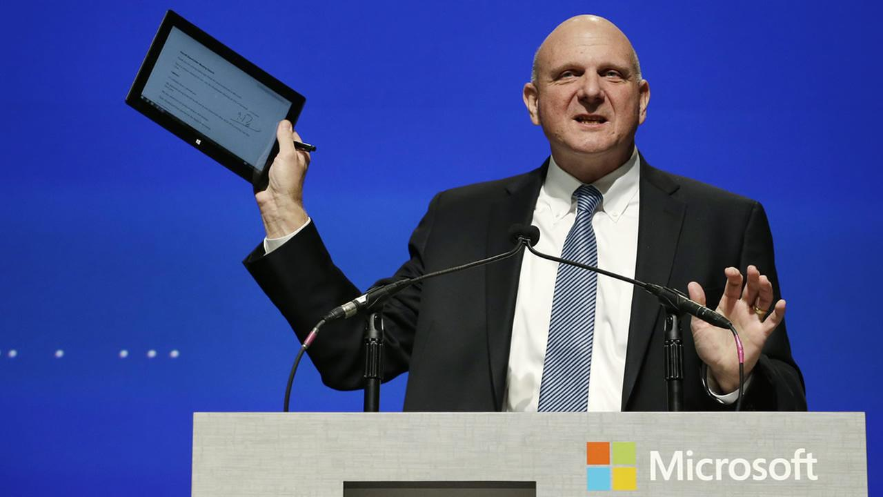 Microsofts Steve Ballmer holds up his personal tablet device as he speaks at the companys annual shareholders meeting Tuesday, Nov. 19, 2013, in Bellevue, Wash. (AP Photo/Elaine Thompson)