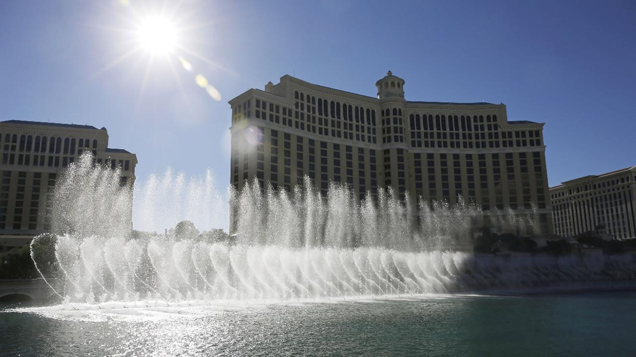 In this Thursday, Aug. 14, 2014 photo, the sun shines on the fountains of the Bellagio, in Las Vegas. (AP Photo/John Locher)