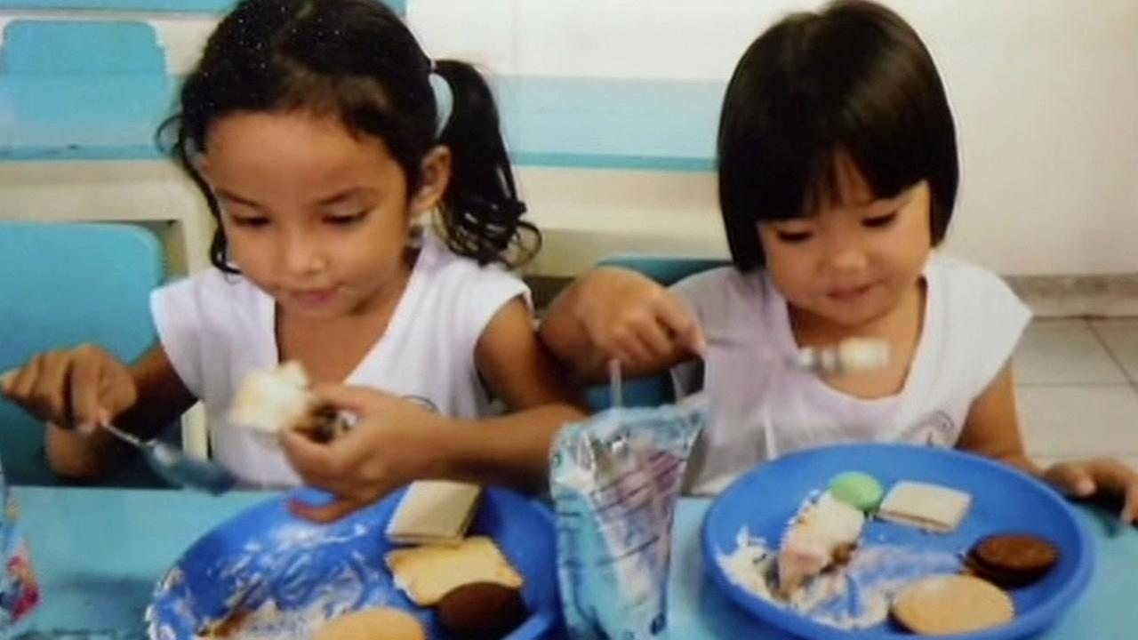 Kids enjoying cake from Sweets For the Holidays at an orphanage