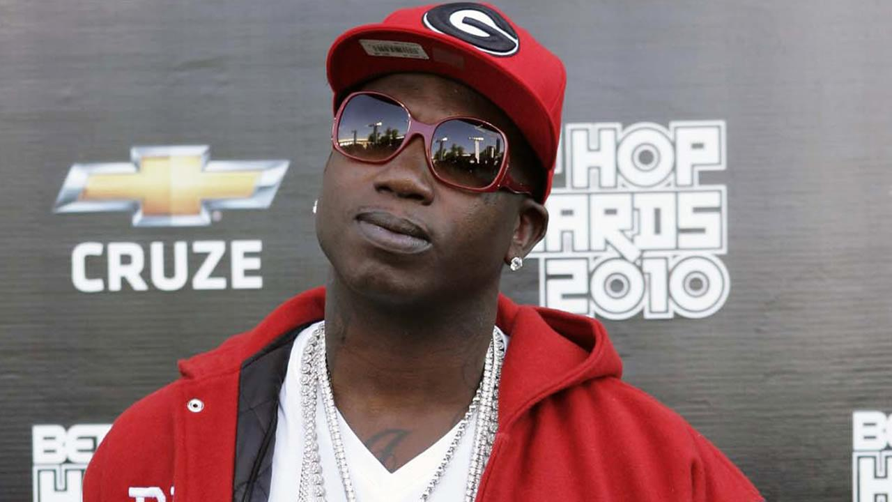 In this Oct. 2, 2010 file photo, rapper Gucci Mane arrives on the red carpet for the BET Hip Hop Awards in Atlanta.  (AP Photo/John Amis, File)